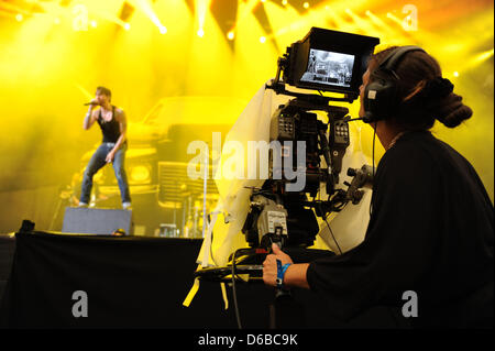 Singer Alec Voelkel of the German band The BossHoss performs on stage at the Veltins-Arena in Gelsenkirchen, Germany, - Stock Photo