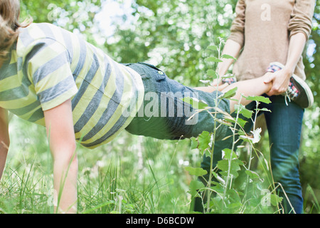 Mother and son playing in park - Stock Photo