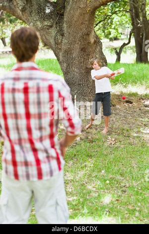 Father and son playing in park - Stock Photo