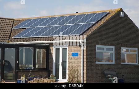 Solar panels on bungalow roof, Walton on the Naze, Essex, UK - Stock Photo
