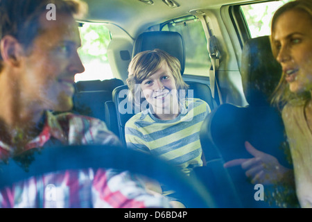 Family riding in car together - Stock Photo