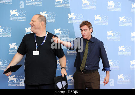 US film producer Harvey Weinstein (L) and US actor Joaquin Phoenix pose during a photocall of the movie 'The Master' - Stock Photo