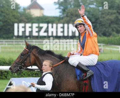 Jockey Andrasch Starke on horse Danedream wins the Grand Prix of Baden during the 'Grosse Woche von Baden' (Week - Stock Photo