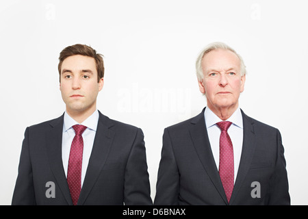 Businessmen standing together - Stock Photo