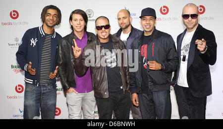 The members of the German hip hop and reggare band Culcha Candela pose for pictures on the red carpet outside the - Stock Photo