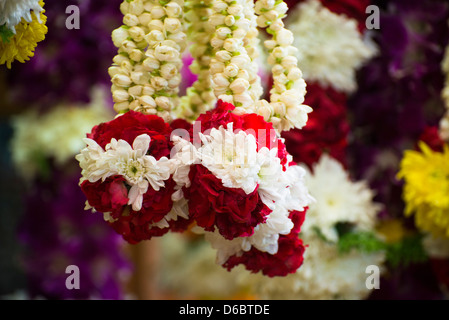 Flower garlands for Indian festivals displayed at a stall. - Stock Photo
