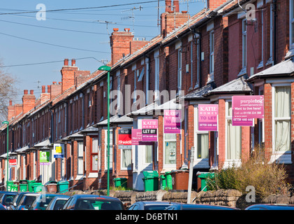 For sale and for rent signs in a residential area mainly for the student population of Nottingham and trent University - Stock Photo