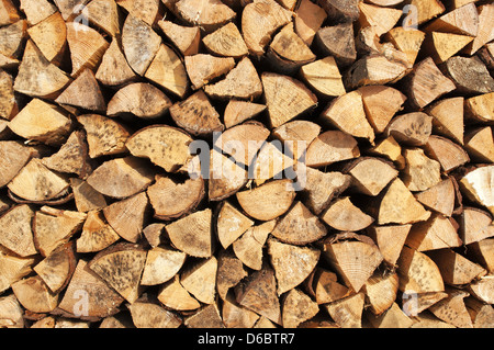 Texture - Chopped and stacked pile of pine and birch wood, cut for fireplace. - Stock Photo