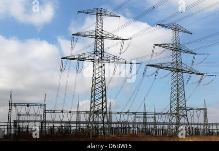 FILE - An archive picture dated 29 March 2011 shows power lines in front of the  transformer station Guestrow, Germany, - Stock Photo