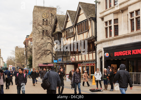 Shoppers in old historic city centre on pedestrianised Cornmarket Street in Oxford, Oxfordshire, England, UK, Britain - Stock Photo
