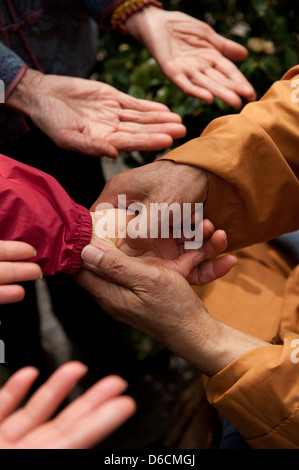 Guangzhou, China, is a monk acupressure with visitors in Filial Piety Temple - Stock Photo