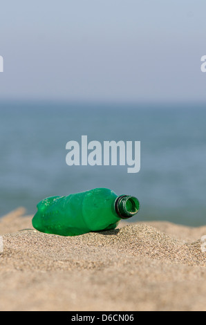 Plastic green bottle on the beach, Spain. - Stock Photo