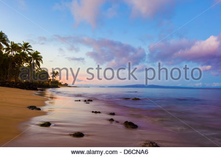 Sunrise at Maipoina Oe Lau  Beach in Kihei on the island of Maui in the State of Hawaii USA - Stock Photo