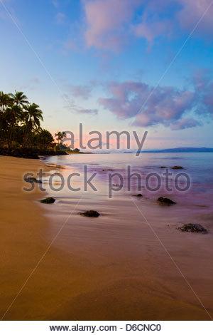 Sunrise at Sugar Beach in Kihei on the island of Maui in the State of Hawaii USA - Stock Photo