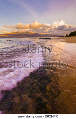 Sunrise at Sugar Beach in Kihei with West Maui Mountains in background on the island of Maui in the State of Hawaii - Stock Photo