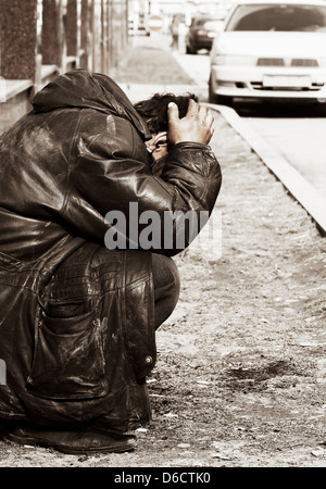Homeless man in despair - Stock Photo