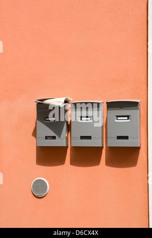 Three mailboxes - Stock Photo