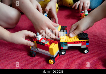 Berlin, Germany, children playing with Lego cars in a daycare center - Stock Photo