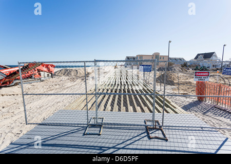 Fenced off boardwalk in Point Pleasant, New Jersey, being rebuild after the Hurricane Sandy destruction - Stock Photo