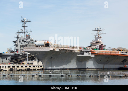 The aircraft carriers USS Harry S. Truman (CVN 75) and USS Abraham Lincoln (CVN-72) at Naval Station Norfolk. - Stock Photo
