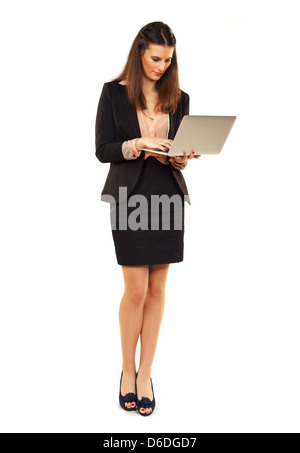 Portrait of a young professional in copyspace using a laptop - Stock Photo