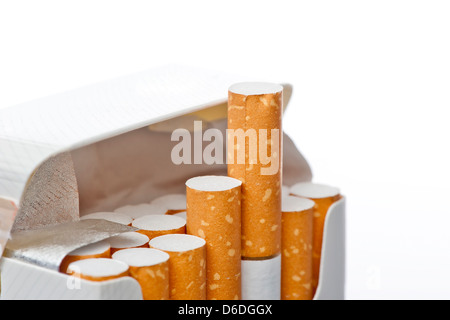 Open pack of cigarettes on a white background - Stock Photo