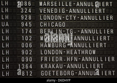 A destination board informs passengers on cancelled flights at a terminal of the Frankfurt airport in Frankfurt - Stock Photo