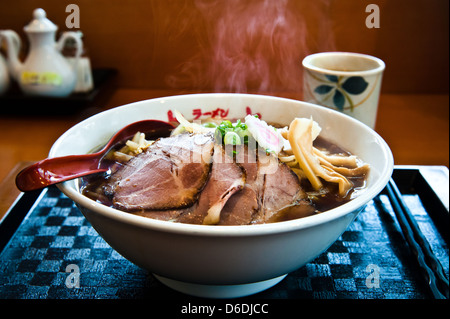 A hot bowl of Miso Ramen (Japanese style noodles in pork/miso broth). Please note the steam above the bowl. - Stock Photo