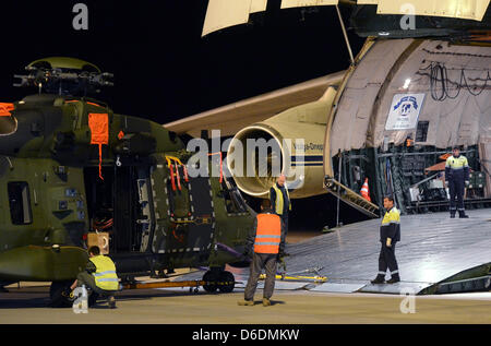 Schkeuditz, Germany, 17 April 2013. The first NH90 multi-purpose helicopter of the German Armed Forces is loaded - Stock Photo