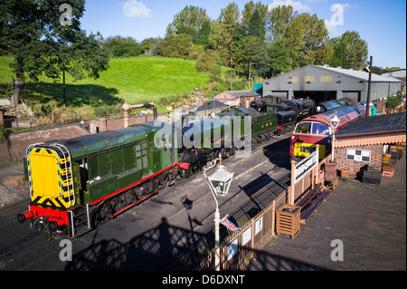 Restored railway engines outside the engine shed at Bridgnorth station on the Severn Valley Railway in Shropshire - Stock Photo