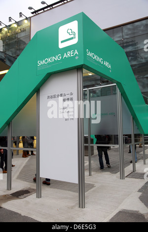 Smoking area in the street for smokers in Shibuya, Tokyo, Japan - Stock Photo