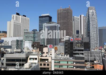 High rise office buildings in Shinjuku city skyline in Tokyo, Japan - Stock Photo