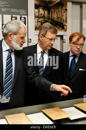 German President Christian Wulff (C) listens to explanations of the director of the memorial and educational site House of the Wannsee Conference, Norbert Kampe (L), during a commemorative event on the occasion of the 70th anniversary of the 'Wannsee Conference' at the House of the Wannsee Conference in Berlin, Germany, 20 January 2012. In this house - a former industrialist's vill