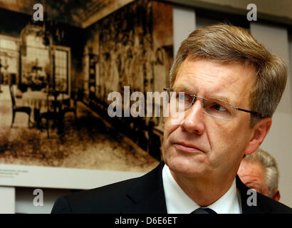 German President Christian Wulff listens to explanations of the director of the memorial and educational site House of the Wannsee Conference, Norbert Kampe (not in picture), during a commemorative event on the occasion of the 70th anniversary of the 'Wannsee Conference' at the House of the Wannsee Conference in Berlin, Germany, 20 January 2012. In this house - a former industriali