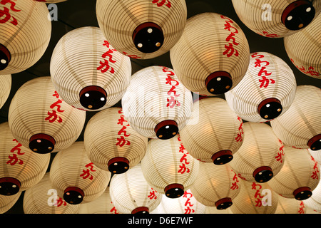 Night street scene of Japanese paper lanterns in Shinjuku, Tokyo, Japan - Stock Photo