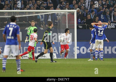 Stuttgart's Shinji Okazaki  (3rd from L) cheers as he runs across the pitch after scoring the 3-1 goal during the - Stock Photo