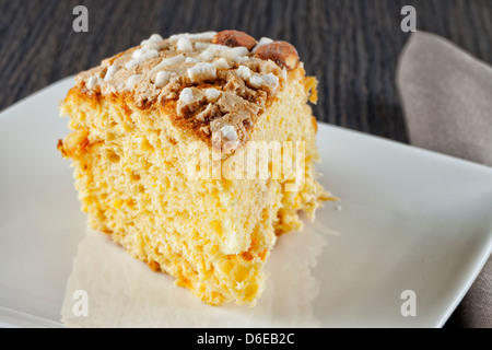 Close up of a slice of cake over white plate - Stock Photo