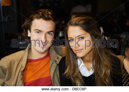Young couple in street cafe Paris France - Stock Photo
