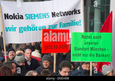 Employees of 'Nokia Siemens Networks' (NSN) protest in front of the biggest German NSN branch in Munich, Germany, - Stock Photo