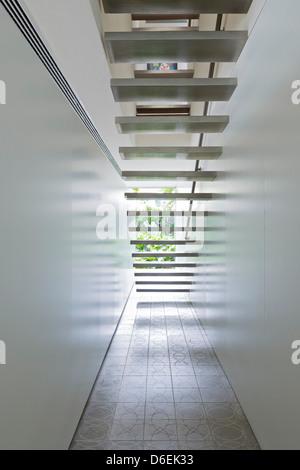 Casa Cubo, Sao Paulo, Brazil. Architect: Studio MK27- Marcio Kogan, 2012. Floating staircase. - Stock Photo
