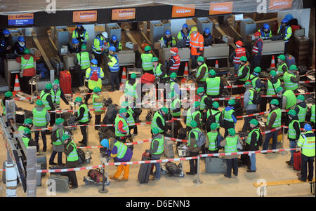 Extras queue up in front the check in terminal during the trial operation of the future airport Berlin-Brandenburg - Stock Photo