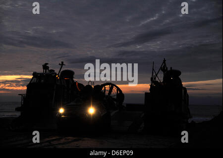An amphibious assault vehicle is offloaded from a landing craft, air cushion (LCAC) Monday, February 6, 2012 during - Stock Photo