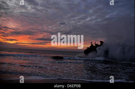 A landing craft air cushion (LCAC) returns Monday, February 6, 2012 to the amphibious assault ship USS Kearsarge - Stock Photo