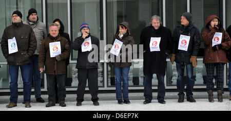 Employees of network supplier Nokia Siemens Networks (NSN) protest the planned closure of the Munich office with - Stock Photo