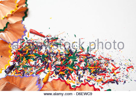 Close up colour pencil sharpenings - Stock Photo
