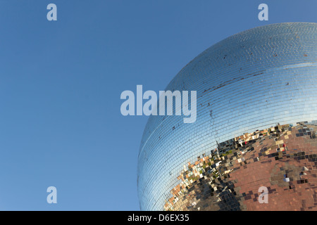 Giant mirror ball by Michael Trainor on the promenade at Blackpool, producing a fragmented reflection of the promenade.. - Stock Photo
