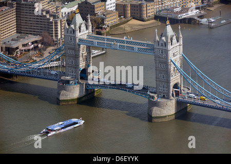 Aerial view from the top of the Shard of Tower Bridge and the River Thames with high speed Thames clipper Pool of - Stock Photo