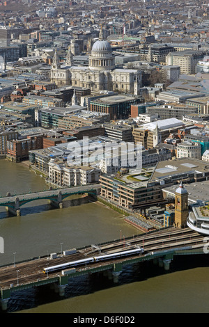 Cannon Street Railway Bridge and station approach with St Pauls cathedral dominating City of London landscape - Stock Photo