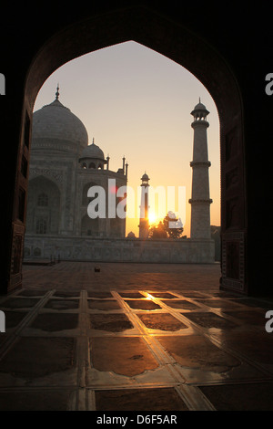 Sunrise view of the Taj Mahal through the arch of Mosque,UNESCO World Heritage Site, Agra  Uttar Pradesh India - Stock Photo