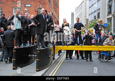 London, UK. 17th April, 2013. People trying to get a view of Margaret Thatcher's funeral at St Paul's Cathedral. - Stock Photo